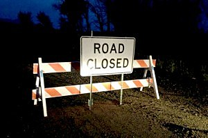 A road closure sign blocks access to Fox Creek Road, Thursday night.