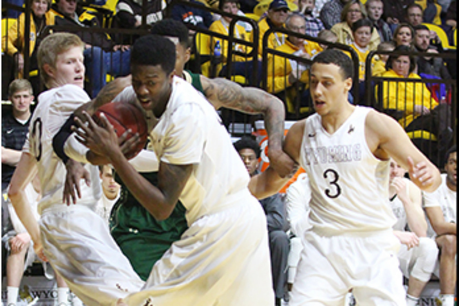 Cowboy players tussle for rebound vs CSU